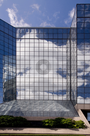 Glass Reflections stock photo, Glass reflections of glass, clouds, and sky. by Charles Buegeler