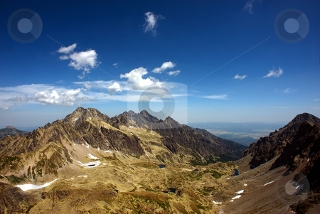Mountain ridge and valley stock photo, Mountain ridge panorama in sunny day with mountain lakes in valley by Juraj Kovacik