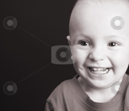 Toddler stock photo, Blonde toddler against a black background with a big smile by Vanessa Van Rensburg