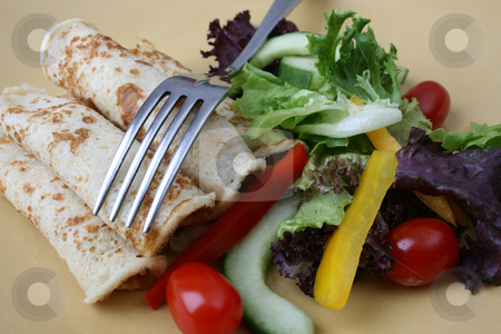 Salad and pancakes with fork stock photo, Fresh Salad and pancakes with a fork by Vanessa Van Rensburg