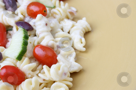 Pasta Salad on plate stock photo, Cold Pasta Salad with tomatoes, cucumbers and olives by Vanessa Van Rensburg