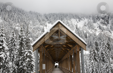Long Snowy Wooden Covered Bridge Washington  stock photo, Long Snowy Wooden Covered Bridge Alpental, Snoqualme Pass, Washington, Northwest by William Perry