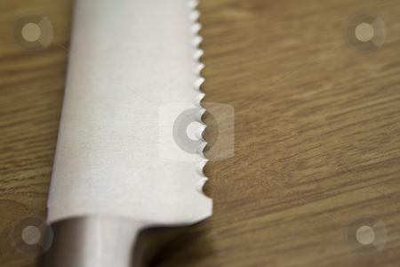 Knife stock photo, Sharp knife on a kitchen bench by Fredrik Elfdahl