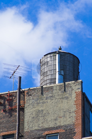 Watertank on the roof stock photo, Watertank on the roof by Fredrik Elfdahl