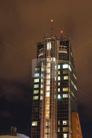 Skyscraper stock photo, Skyscraper rising in the night by Fredrik Elfdahl