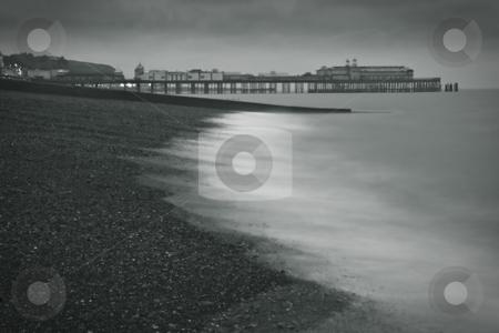 A pier at the beach stock photo, A pier at the beach by Fredrik Elfdahl