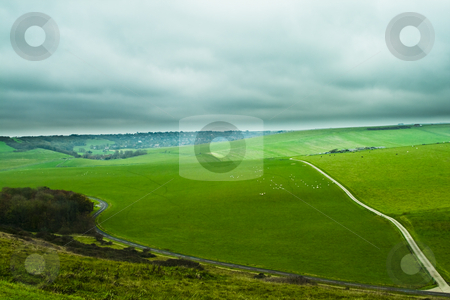 Green hill stock photo, Green hill with a road by Fredrik Elfdahl