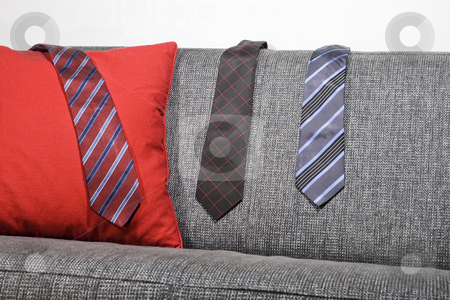 Sofa and ties stock photo, Ties hanging on a sofa by Fredrik Elfdahl
