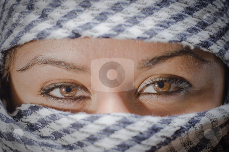 Dark eyes stock photo, Girl with dark eyes and a scarf by Fredrik Elfdahl