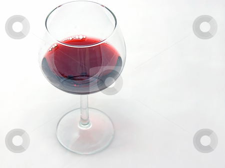 A Single Glass of Red Wine Isolated On White stock photo, This photo is a single glass of red wine isolated on a black background. by Valerie Garner