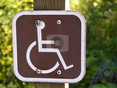 Handicapped Sign stock photo, This sign with a wheelchair is brown and white signalling a symbol for the handicapped. by Valerie Garner