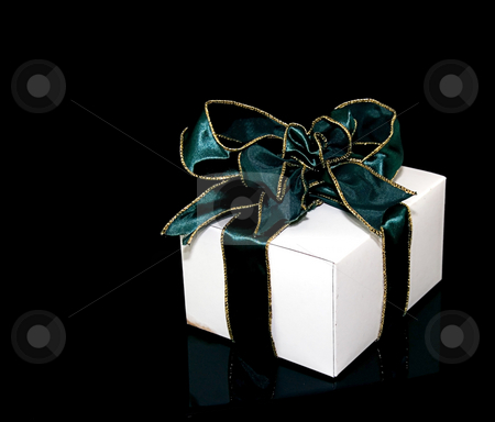 One Gift With Green Ribbon stock photo, This is one gift in a white box with a green metallic gold edged wire ribbon against a black background. by Valerie Garner