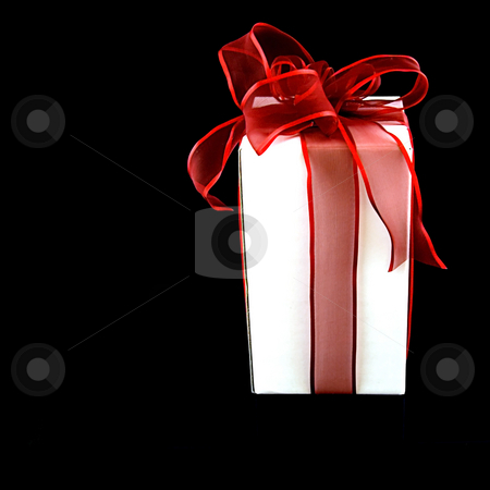 One Gift With Red Ribbon stock photo, This is one gift in a white box wrapped with a red, sheer and shiny bow on a black background. by Valerie Garner