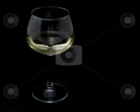 Glass of White Wine stock photo, This photo is one glass of white wine in a long stemmed glass with a black background. by Valerie Garner