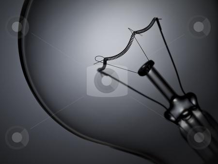Bulb light off stock photo, Close up on a transparent light bulb over a grey background. by Ignacio Gonzalez Prado