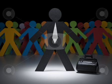 Paper businessman stock photo, A paper businessman stands under the spotlight in front of multicolor crew. by Ignacio Gonzalez Prado