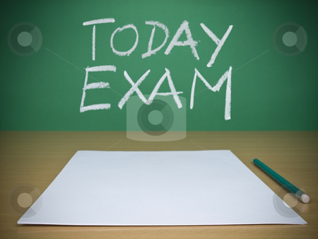 Today exam stock photo, A few blank paper sheets ready for been filled in a exam. by Ignacio Gonzalez Prado