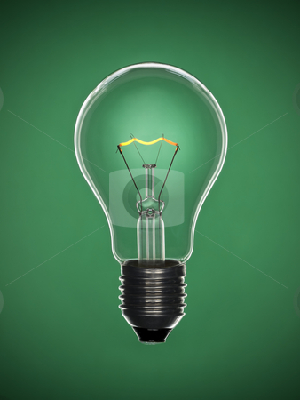 Bulb light over green stock photo, A transparent light bulb over a green background. Tungsten glowing filament. by Ignacio Gonzalez Prado