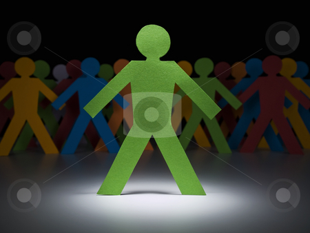 Green paper men stock photo, A green paper figure stands under the spotlight in front of multicolor crew. by Ignacio Gonzalez Prado
