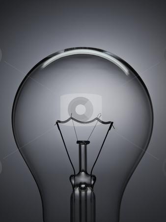 Bulb light over grey stock photo, Close up on a transparent light bulb over a grey background. by Ignacio Gonzalez Prado