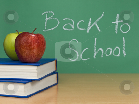Back to school stock photo, Back to school written on a chalkboard. Two apples over books on the foreground. by Ignacio Gonzalez Prado
