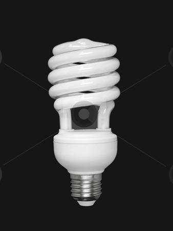 Fluorescent light bulb over black stock photo, Compact fluorescent light bulb isolated over black background. by Ignacio Gonzalez Prado