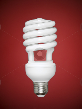 Fluorescent light bulb over red stock photo, Compact fluorescent light bulb over a red background. by Ignacio Gonzalez Prado