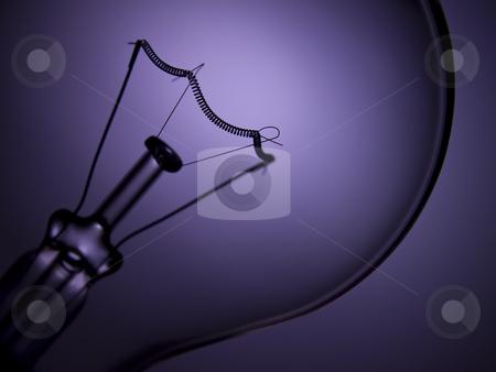 Bulb light over purple stock photo, Close up on a transparent light bulb over a purple background. by Ignacio Gonzalez Prado
