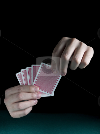 Gambling hand stock photo, A man's hand holding five cards over a green felt. by Ignacio Gonzalez Prado
