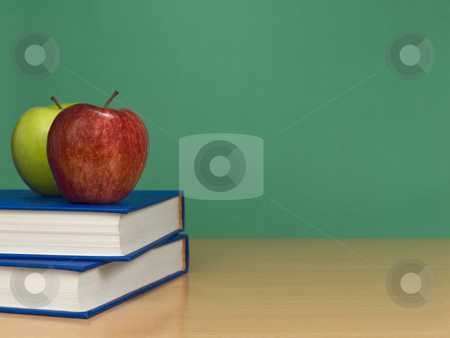 Blank chalkboard stock photo, A blank chalkboard with two apples over books. by Ignacio Gonzalez Prado