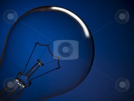 Bulb light over blue stock photo, Close up on a transparent light bulb over a blue background. by Ignacio Gonzalez Prado