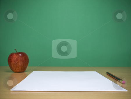 A new lesson stock photo, A few blank sheets ready for been filled in the classroom. by Ignacio Gonzalez Prado