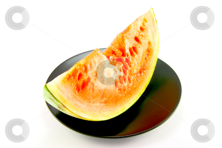 Watermelon with Bite Mark stock photo, Slice of watermelon with green skin and red melon with seeds and bite mark on a black plate with a white background by Keith Wilson