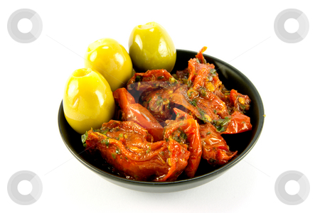 Sun Dried Tomatoes and Olives stock photo, Pile of red sun dried tomatoes with three green olives in a small black dish on a white background by Keith Wilson