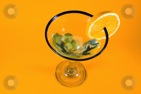 Martini Glass stock photo, Martini Glass - Isolated on Orange Background by Mehmet Dilsiz