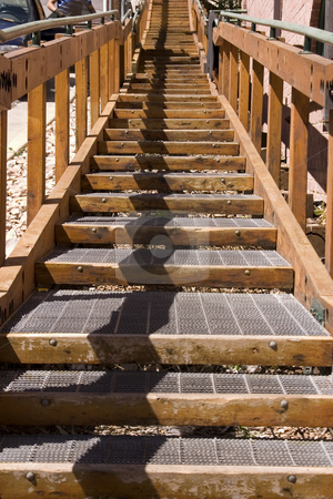 Wooden Stairs going up in the City stock photo, Wooden Stairs going up in the City by Mehmet Dilsiz