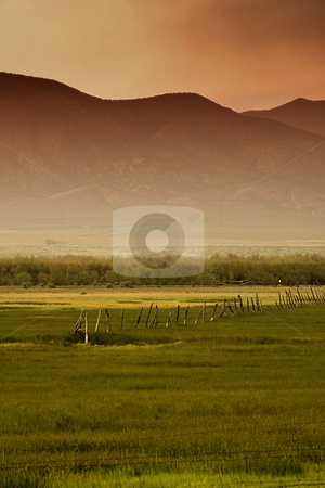 Rural Scene stock photo, Rural Scene in Utah with Mountains as the Background by Mehmet Dilsiz