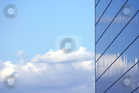 Mirrored Business Building stock photo, Sky reflecting from the Mirrored Business Building by Mehmet Dilsiz