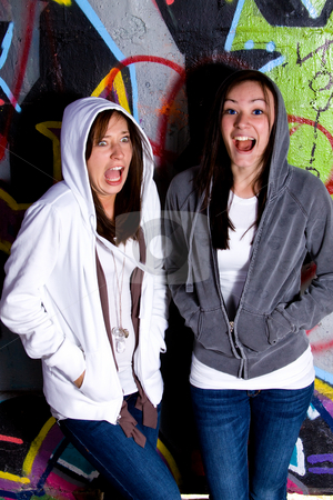Teenage Girls Making Faces stock photo, Teenage Girls Making Faces with a Grafitti Background by Mehmet Dilsiz