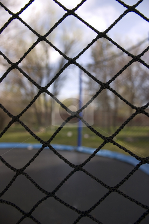Trampoline stock photo, Close up on a Net of a Trampoline by Mehmet Dilsiz