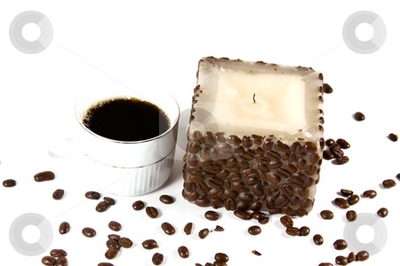 Cup of Coffee and Candle stock photo, Isolated Shot of a candle with a cup of coffee by Mehmet Dilsiz
