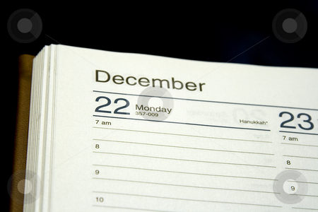 Close up on a Date in a planner stock photo, Close up on the date of Hanukkah in a planner by Mehmet Dilsiz