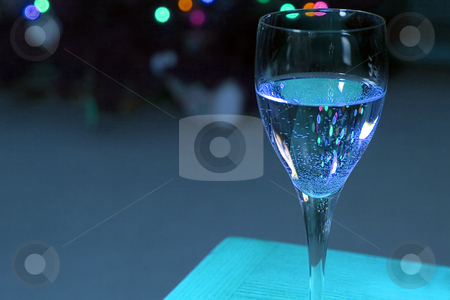 Up Close on a Wine Glass stock photo, Close up on a Wine Glass with the Christmas lights on the background by Mehmet Dilsiz
