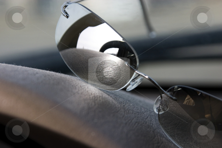 Sunglasses on the deck stock photo, Steering wheel reflection on the sunglasses on the deck by Mehmet Dilsiz
