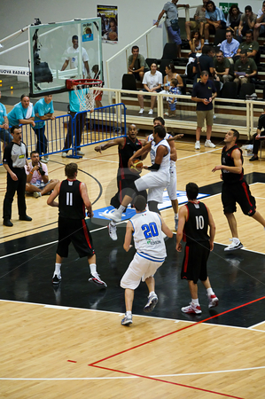 FIBA Trentino Cup: Italy vs Canada stock photo, Game 2 of FIBA Trentino Cup: Italy vs Canada. The tournament was played in Trento (Italy) between the 25th and the 27th of July 2009. Acrobatic play of Marco Belinelli going for the spectacural assist in the heart of Canadian defense. Photo taken on the 25th of July, 2009 by Alessandro Rizzolli