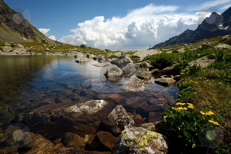 Mountain lake with view under surface stock photo, Mountain lake on plateau with a view under surface in sunny summer day with some clouds on horizon by Juraj Kovacik