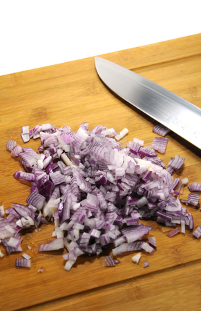 Cutted onions stock photo, Cutted onions with a knive by Sigrid Wittmann