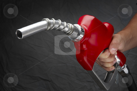 Fill up stock photo, Man with gas nozzle in hand at gas station by James Barber