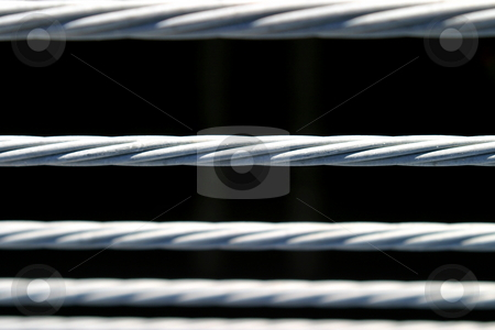 Metal Fence stock photo, Metal fence wire on a black background by Henrik Lehnerer