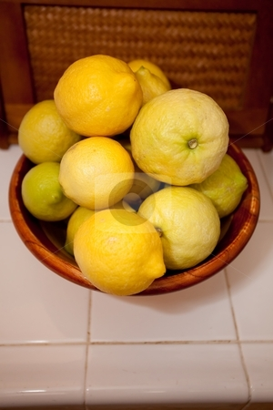 Lemons stock photo, The lemon is the common name for Citrus limon. The reproductive tissue surrounds the seed of the angiosperm lemon tree. by Mariusz Jurgielewicz